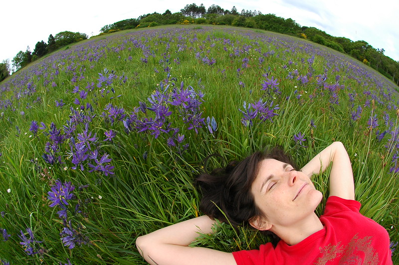 """This is a self portrait I took for a """"dreaming"""" photo challenge with dpchallenge.com (and won first place!). I decided to see what the lens would do in a flower meadow in Victoria B.C. The camera is INCHES from my face."""