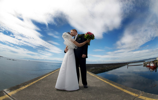 This is the same couple, only inverted to look more like a wide angle. I couldn't have asked for a better dramatic sky to add a finishing touch.