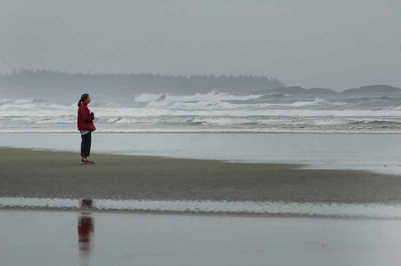 A woman stands alone on a beach - Stock Photo by Nature Photographer Christina Craft