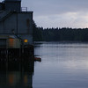 The lights turn on in a fishery at the ocean at sunrise or sunset - Stock Photo by Nature Photographer Christina Craft