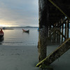 Tofino - aborginal canoes docked at low tide - Stock Photo by Nature Photographer Christina Craft