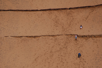 Kids sliding down a sand dune in Kiwanda Oregon - Nature Stock Image by Professional Nature Photographer Christina Craft