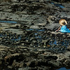 Victoria British Columbia - girl / child sitting on rocks at low tide Stock Photo by Nature Photographer Christina Craft