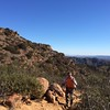 12/26 walking up 'suicide hill' to get to China Flat, then on to Simi Peak, although too windy to stay at the top.