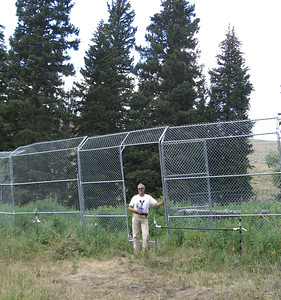 Carter Niemeyer in front of the original pen in Rose Creek which housed the first wolves brought into Lamar Valley for reintroduction ten years ago.