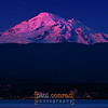 © Paul Conrad/Pablo Conrad Photography - The last rays of the setting Sun bathes the snow-capped peak of Mount Baker in alpenglow as the lights of the city of Bellingham, Wash., begin to turn on during evening April 23, 2013.© Paul Conrad/Paul Conrad Photography - Rights limited to laptop/desktop computer usage only. No printing allowed.