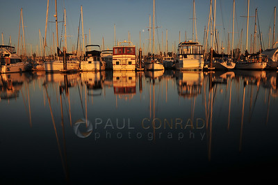 © Paul Conrad/Pablo Conrad Photography - The setting sun cast a warm glow on the boats at the Everett Marina north of Seattle, Wash.