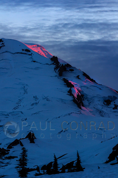 Lava on the Mountain - The colors of the setting Sun ignite the snowfields atop Mount Baker on Saturday evening July 16, 2017, from Artist Point in Whatcom County, Wash. (© Paul Conrad/Paul Conrad Photography)
