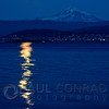 © Paul Conrad/Pablo Conrad Photography  A ful Harvest Moon is reflected in Bellingham Bay as it rises near Mount Baker east of Bellingham, Wash.