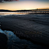 © Paul Conrad/Pablo Conrad Photography - Light from the setting sun illuminates a stream at Squalicum Beach in Bellingham, Wash.
