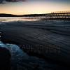 © Paul Conrad/Pablo Conrad Photography - Light from the setting sun illuminates a stream at Squalicum Beach in Bellingham, Wash.