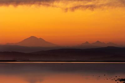 Layered Cascade Mountains at Sunrise