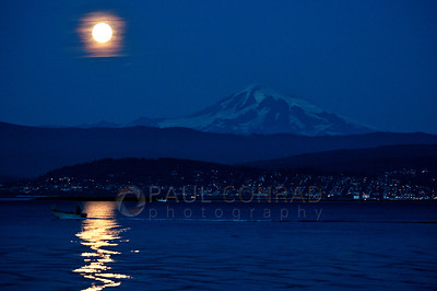 © Paul Conrad/Pablo Conrad Photography - The Moon rises near Mt. Baker east of Bellingham, Wash., on Sunday September 30, 2012, as seen from the Lummi Reservation on Lummi Shore Drive.