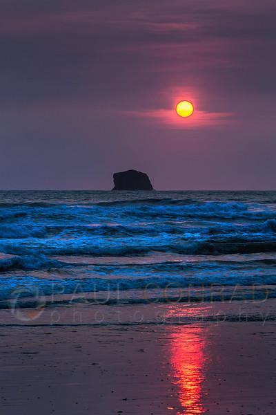 © Paul Conrad/Pablo Conrad Photography - The Sun sets over a rock formation in the Pacific Ocean near Rialto Beach along the western Washington coast near La Push.