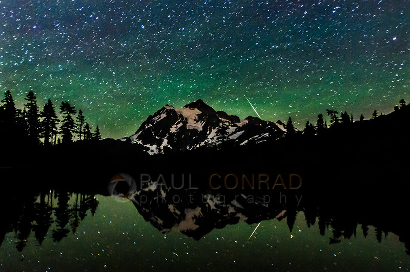 A lone meteor flares over Mount Shuksan during the 2016 Perseids Meteor Shower on Friday morning Aug. 8, 2016, at Picture Lake near Mount Baker Ski Area in Whatcom County, Wash. (© Paul Conrad/Paul Conrad Photography)
