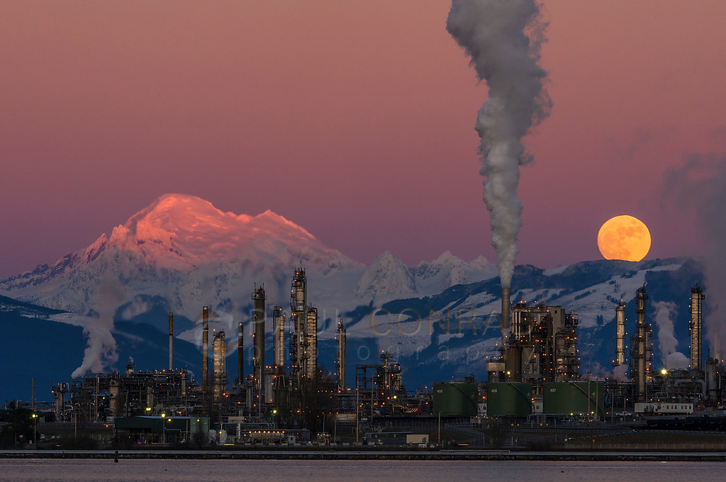 Beauty & The Beast - The full Moon rises over the Tesoro refinery in Anacortes, Wash., as Mount Baker is bathed in the Sun's last rays on Wednesday evening Jan. 11, 2017. (© Paul Conrad/Paul Conrad Photography)