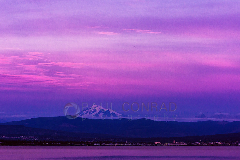 Pink Skies over Mount Baker and Bellingham, Wash. - Mount Baker appears to loom over Bellingham and Western Washington University on Thursday evening Sept. 29, 2016, during sunset as seen from Lummi Shore Drive. (© Paul Conrad/Paul Conrad Photography)