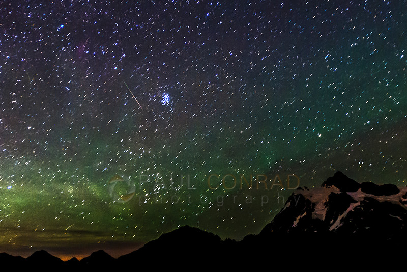 Streaker by Pleiades Cluster - A meteor streaks by the Pleiades during the Perseids Meteor Shower on Friday morning Aug. 8, 2016, at Artist Point near Mount Baker Ski Area in Whatcom County, Wash. (© Paul Conrad/Paul Conrad Photography)