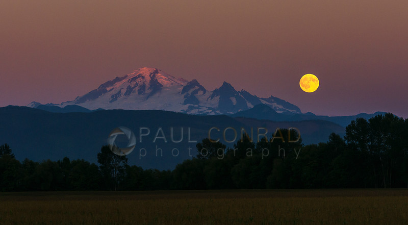 Full Moon over Mount Baker - The near full Moon rises over Mount Baker on Wednesday evening Aug. 17, 2016, as seen from south of Lynden, Wash., along Guide Meridian. (© Paul Conrad/Paul Conrad Photography)