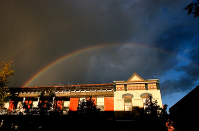 Paul Conrad/The Aspen Times A rainbow from a passing storm arches over the Brand Building after the brief shower drenched Aspen just before sunset Thursday August 18, 2005.