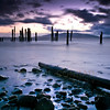 © Paul Conrad/Pablo Conrad Photography  Storm clouds and raging surf above and around the pilings at Locust Beach along Bellingham Bay in Bellingham, Wash.