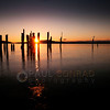 © Paul Conrad/Pablo Conrad Photography<br /> <br /> The setting Sun creates a starburst between two pilings on Locust Beach in Bellingham, Wash.