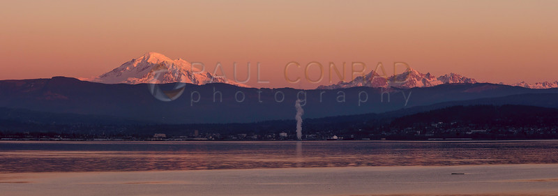 Mount Baker and the Twin Sisters are ignited by the setting Sun. (© Paul Conrad/Paul Conrad Photography)