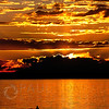 © Paul Conrad/Pablo Conrad Photography - A kayaker negotiates Bellingham Bay during a brilliant sunset at Boulevard Park on Tuesday evening Sept. 4, 2013, in Bellingham, Wash.