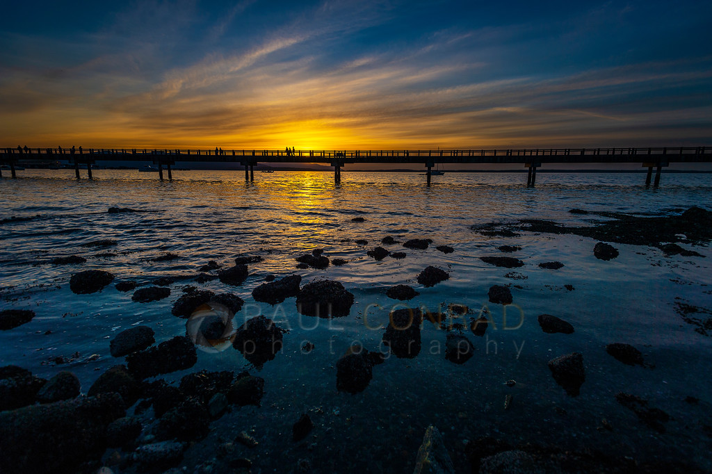 Low Tide Sunset - The sun sets behind the Boardwalk during a low tide on Mondayday evening March 29, 2021, in Bellingham, Wash. (photo © Paul Conrad/@PaulConrad.Photography)