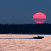 © Paul Conrad/Pablo Conrad Photography<br /> <br /> A boat zooms across as the sun sets over Bellingham Bay in Bellingham, Wash.