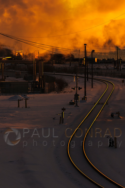 Railroad Tracks and Sunset - The setting Sun ignites the railroad tracks and steam from the Puget Sound Energy Encogen Generating Station on Cornwall Avenue in Bellingham, Wash. (© Paul Conrad/Paul Conrad Photography)