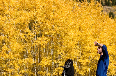 © 2008 Paul Conrad/Sky Fire Photography Surrounded on all sides by peaking aspens, Jason Manke of Boulder, Colorado, chooses his angle while photographing the colors along Castle Creek Road outside of Aspen, Colorado.   Send Me Your Thoughts and Questions