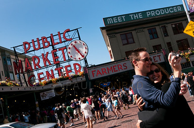 © Paul Conrad/Pablo Conrad Photography  A couple takes a self portrait in front of Seattle's famous Pike Place Market on Saturday morning August 11, 2012.