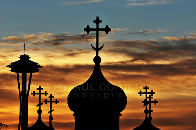 © Paul Conrad/ Sky Fire Photography The sun sets behind the Space Needle and St. Spiridon Orthodox Cathedral in Seattle, Wash.  Send Me Your Thoughts and Questions