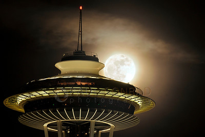 "© Paul Conrad/Pablo Conrad Photography The ""super perigee"" Moon, Supermoon, rises over the Space Needle in Seattle, Wash., on Saturday Mar. 19, 2011."