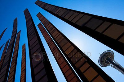 "© Paul Conrad/Pablo Conrad Photography  The Space Needle framed by the sculpture ""Blades of Grass"" at the Seattle Center in Seattle, Wash."