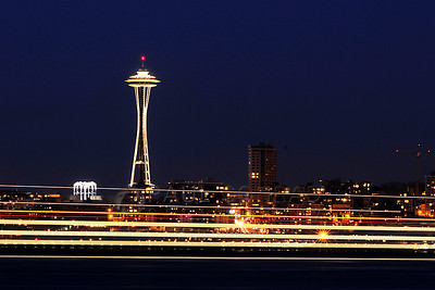 © Paul Conrad/Pablo Conrad Photography A ferry sails across the Puget Sound in front of the Space Needle in Seattle, Wash., on Saturday March 19, 2011.