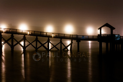 © Paul Conrad/Pablo Conrad Photography  The Boardwalk at Boulevard Park is silhouetted against distant street lights in Bellingham, Wash., during a foggy Sunday night Jan. 20, 2013.