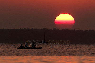 © Paul Conrad/Pablo Conrad Photography  Kayakers watch the Sun set over Bellingham Bay in Bellingham, Wash.