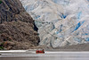 A tourist boat is dwarfed by the calving face of a glacier in Alaska, #0135