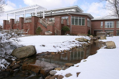 As the sun broke out and temperatures started to rise following last weekend's snowfall, water flowed freely in a creek between the snowscape at St. George Village, Roswell, Feb. 13.