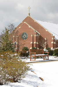 From the snowscape grounds of St. George Village, Roswell, the snow-topped roof of St. Peter Chanel Church looms in the background. Afternoon temperatures started to push upward and a slow meltdown ensued Feb. 13, following the previous day's snowfall that left 3-6 inches around the metropolitan Atlanta area.