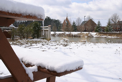 The snow-topped roof of St. Peter Chanel Church, Roswell, can be seen from the snowy grounds of St. George Village. As afternoon temperatures started to rise Feb. 13, following the previous day's snowfall that left 3-6 inches around the metropolitan Atlanta area, a slow meltdown ensued.
