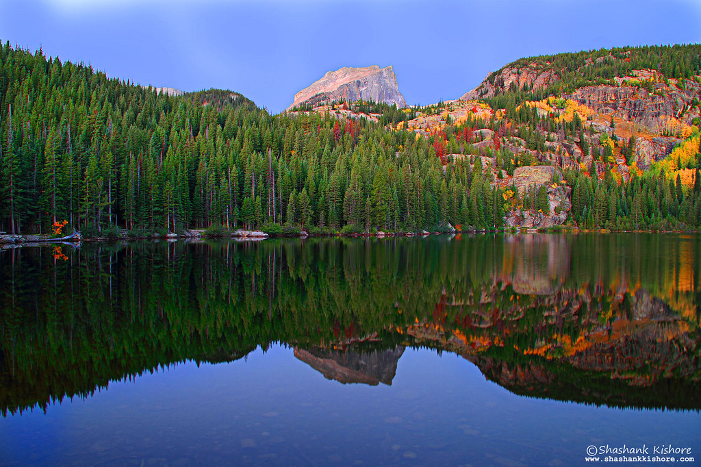 Location - Bear lake, RMNP CO, USA<br /> Shot 10 min before Sunrise. Great reflection can be captured during sunrise or sunset.  (Second week of Sept 2010)<br /> Canon 7D, 17-85@17mm, f9, ISO-160, 4 Sec.<br /> <br /> I was lucky enough to capture the reflection. I was able to take just 4-5 shots and wind started blowing which ruined the reflection. I recommend arriving 30 min before Sunrise or Sunset at the spot which i could not do. If you get plenty of time, you can set multiple exposures and take shots in different compositions.