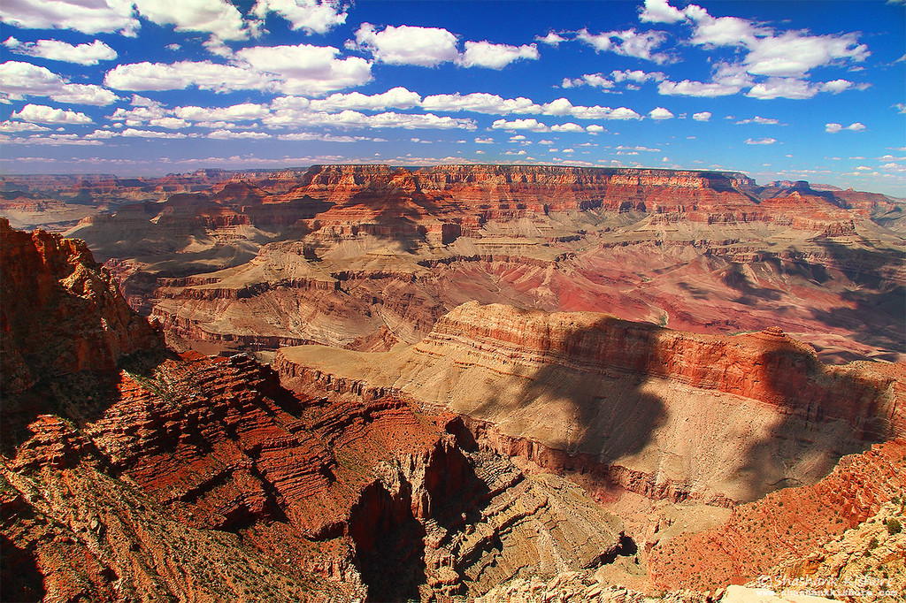 Location - Grand canyon South Rim, AZ, USA<br /> (Second week of Sept 2010)<br /> Canon 7D, 17-85@17mm, f11, ISO-100, Circular Polarizer.<br /> <br /> It was a beautiful sunny day and luckily interesting sky. I used a circular polarizer to retain the sky color.