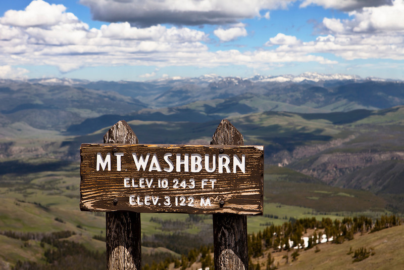 The sign at the summit of Mt. Washburn which, at an elevation of 10,243 feet, is the highest point in Yellowstone National Park.