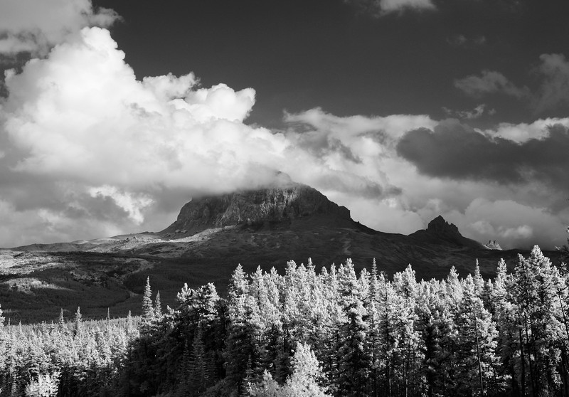 Big Chief Mountain in Glacier National Park is a granite monolith that rises from the low-lying hills nearby. In black and white infrared.