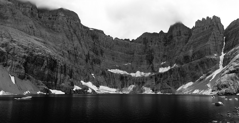View of Iceberg Lake in Glacier National Park in late summer. The glaciers and ice fields have nearly melted although there are still icebergs floating in the lake. In black and white infrared.