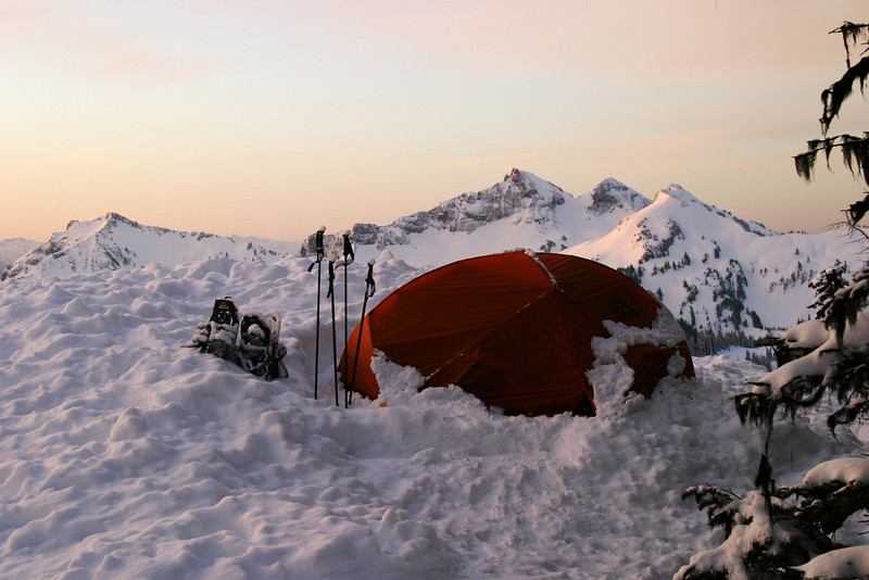 After a snowstorm adventure over the previous night, an early morning sunrise greeted our group on Mt. Rainier. The tent was one of our shelters.