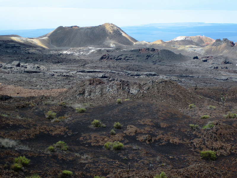 A cinder cone is visible in the volcanic landscape on the side of the Sierra Negra volcano on Isabel Island in the Galapagos.